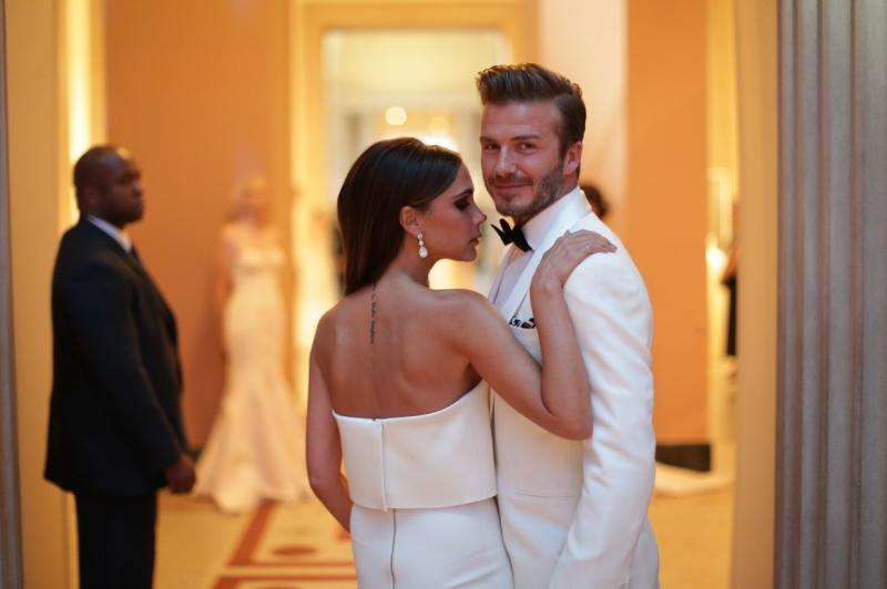 David si Victoria Beckham, in timp ce pozeaza sexy spre camera