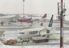 Probleme pe aeroporturi din cauza condițiilor meteo